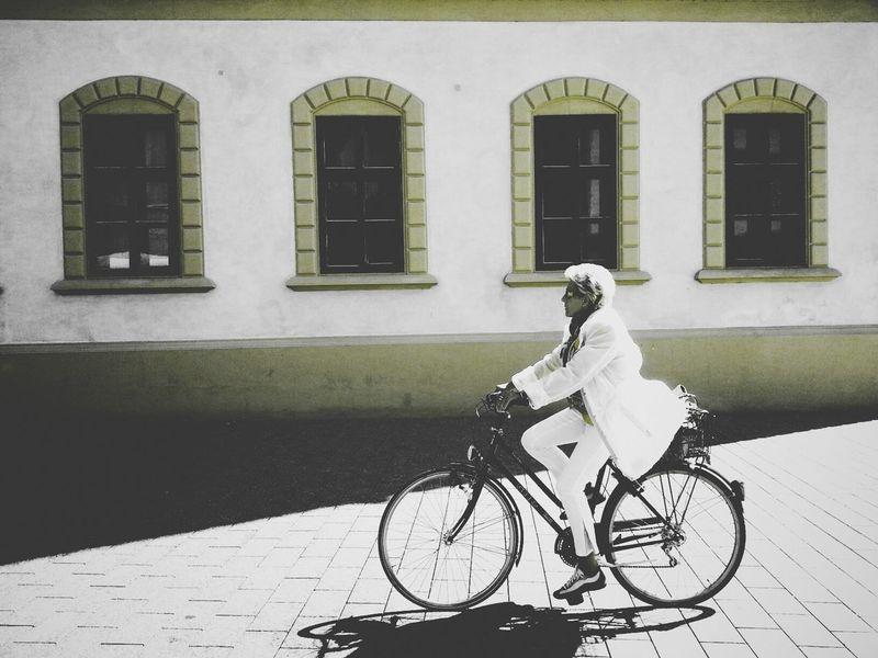 White Rider Andrographer Liechtenstein Peoplecyclingpastwalls Streetphoto_color
