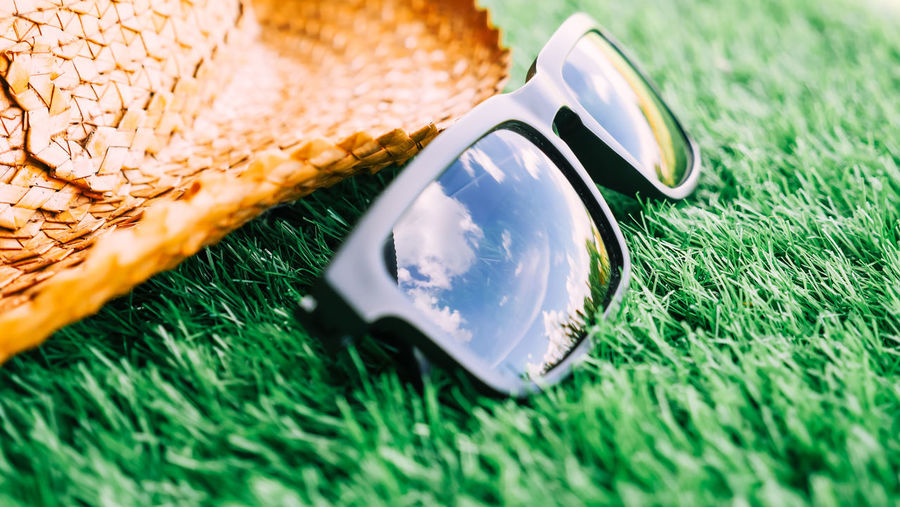 High angle view of sunglasses on grassy field