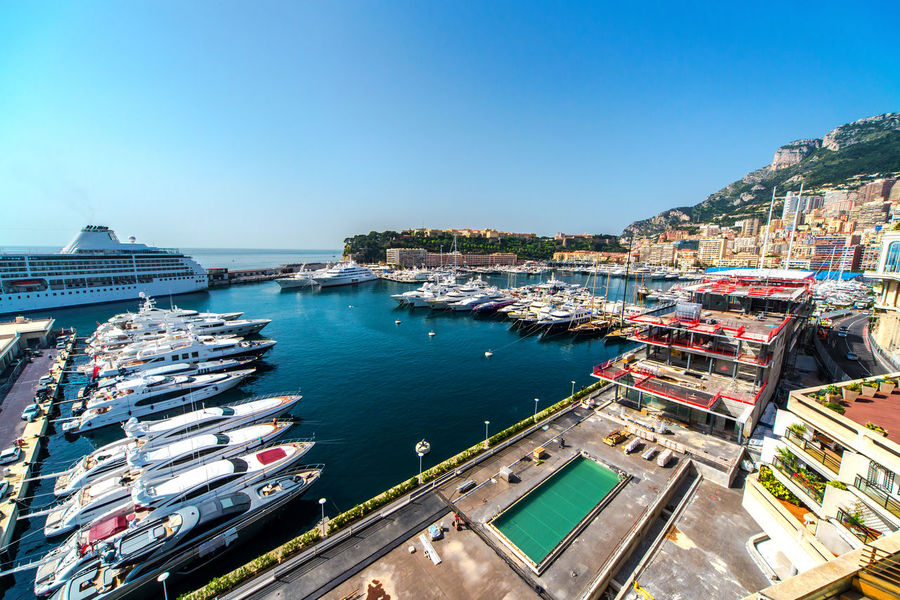 View of Monaco harbor Harbor Monaco Architecture Building Exterior Built Structure City Cityscape Clear Sky Day Mode Of Transport Moored Nature Nautical Vessel No People Outdoors Port Principality Of Monaco Sea Sky Sunny Day Transportation Travel Destinations Waterfront Yacht Yachting