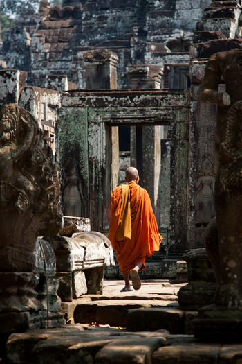 Rear View Of Monk Walking In Angkor Wat
