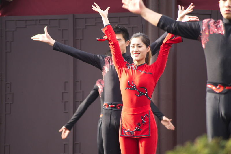 Actor Amusement Park Arms Outstretched Arts Culture And Entertainment Dancer Dancing Day Front View Motion Outdoors People Performance Performing Arts Event Phantasialand Real People Red Standing Women Young Women