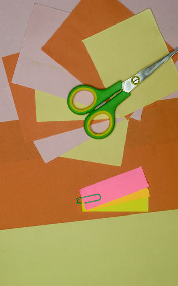 High angle view of multi colored paper on table
