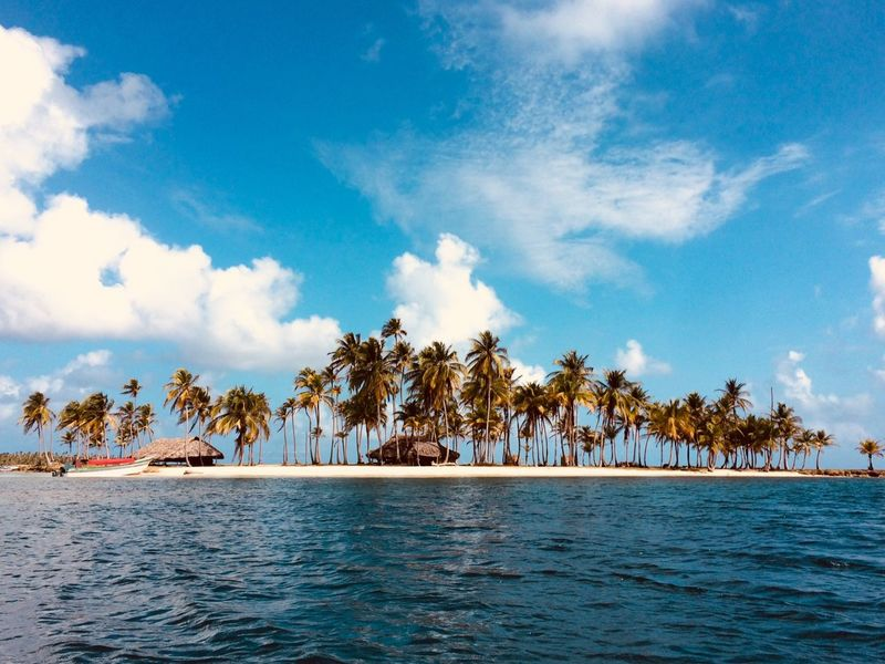 lonely Island with perfect beach, palm trees a boat and a hut - summer vacation Island, Lonely Panamá Travel Beach Beachlife Beauty In Nature Blue Cloud - Sky Day Nature No People Outdoors Palm Tree People San Blas Island Scenics Sea Sky Summer Summer, Tranquil Scene Tranquility Tree Water