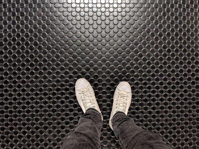Low Section Standing Human Leg Men Shoe Black Color Personal Perspective Pattern Metal Grate