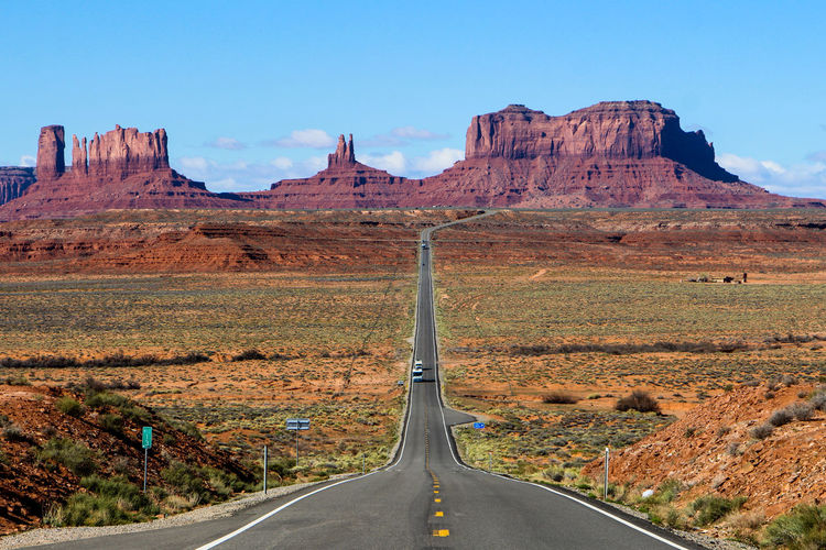Transportation Road Sky Mountain Landscape The Way Forward Scenics - Nature Non-urban Scene Nature Direction Day Rock Travel Tranquil Scene Beauty In Nature Rock Formation No People Environment Remote Sign Mountain Range Formation Outdoors Climate Diminishing Perspective Monument Valley Forest Gump