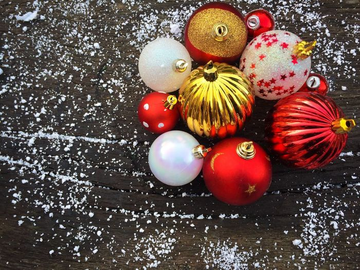 Red and white glittering Christmas globes on rustic wooden table powdered with snow High Angle View Celebration Christmas No People Preparation  Christmas Decoration Close-up Freshness Day Christmas Globes Table Wooden Rustic Hang Round Globes Christmas Glitter Decorations Festive Holiday Snow Winter