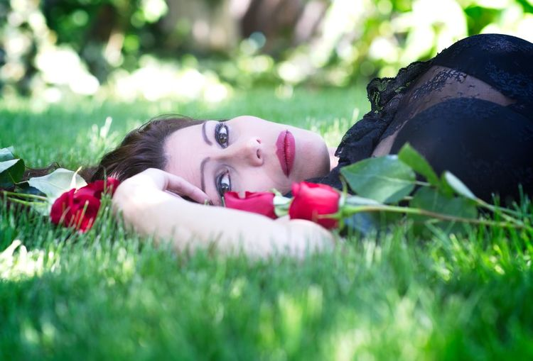 Nikon Beautiful Woman Grass Headshot Leisure Activity Lifestyles Looking At Camera Lying Down Nature One Person Outdoors Plant Portrait Real People Relaxation Roses Selective Focus Women Young Adult Young Women
