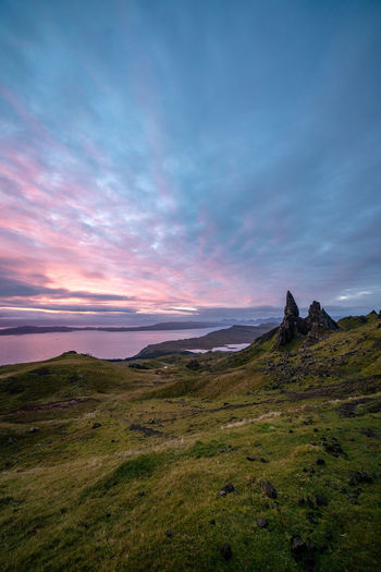 Sky Cloud - Sky Beauty In Nature Tranquil Scene Scenics - Nature Tranquility Sunset Nature Landscape Land Mountain Non-urban Scene No People Grass Outdoors Idyllic Rock Scotland Old Man Of Storr Sunrise Pink Sky Highlands Highlands Of Scotland Remote Environment Isle Of Skye