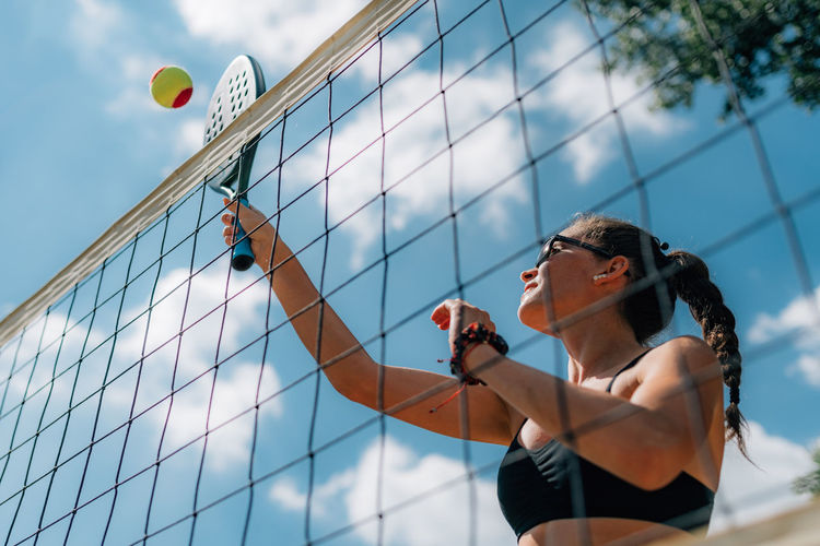 Beach tennis player at the net
