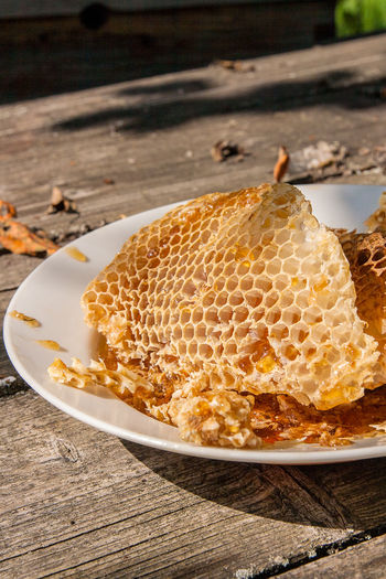 APIculture Bee Close-up Day Focus On Foreground Food Food And Drink Freshness High Angle View Honey Honeycomb Indoors  Nature No People Plate Still Life Sweet Food Table Waffle Wood - Material