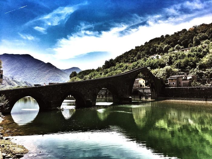 Bridge - Man Made Structure Water Arch No People Outdoors Cloud - Sky Tree Day Architecture Sky Built Structure Mountain Nature Beauty In Nature Devil's Bridge Ponte Del Diavolo Lucca Lucca Italy Garfagnana Picoftheday Sunny Sunny Day