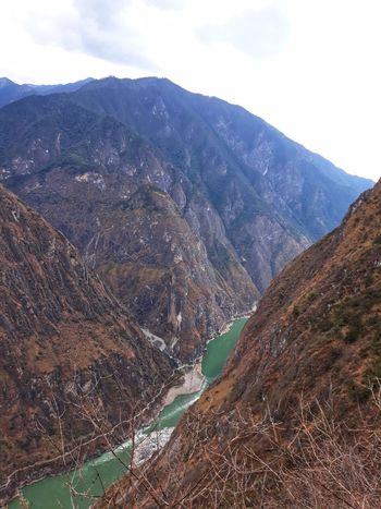 Scenics Scenics - Nature Scenery River Green Color Water Rock Mountain Lijiang Yunnan ,China Yangtze River Hike Blue Sky Jade Snow Mointain Haba Mountain China Travel Tiger Leaping George Mountain Tree Rural Scene Agriculture Sky Landscape Mountain Range Cloud - Sky Hiker