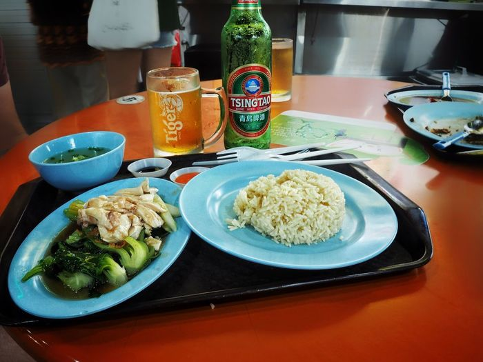 Hainanese chicken rice in a Singapore food hall Food And Drink Food Plate Table Healthy Eating Serving Size Ready-to-eat Indoors  Freshness High Angle View No People Bowl Vegetable Drink Meal Meat Close-up Day Traditional Food Singapore Chicken Rice Chicken Rice