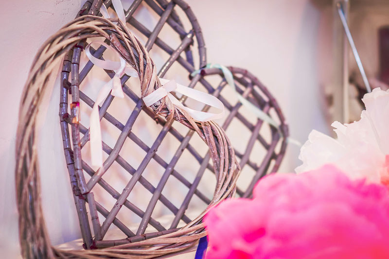 Close-up of pink wicker basket on table