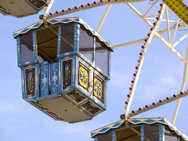 Amusement Park Amusement Park Ride Architecture Arts Culture And Entertainment Blue Building Exterior Built Structure Communication Day Hanging Lighting Equipment Low Angle View Metal Nature No People Outdoors Pattern Sign Sky Text