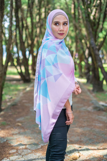 Portrait of lovely young Malay woman, modern stylish Muslim fashion, nature background. Selective focus. One Person Lifestyles Malaysia Malay ASIA Muslim Young Adult Attractive Fashion Modern Wood - Material Wood Forest Beauty In Nature Sky Tree Tranquility Stylish Style Plant People Real People Relaxing Close-up City Nature Mountain Day Hanging Out Growth Green Color Grass Travel Beautiful Portrait Standing Focus On Foreground Land Leisure Activity Young Women Women Looking At Camera Adult Smiling Three Quarter Length Casual Clothing Beautiful Woman