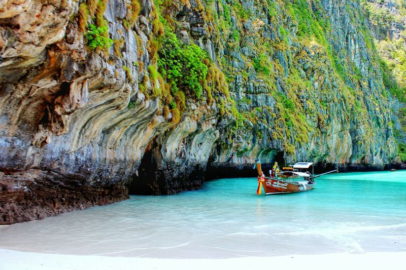 Boat on the beach... Boat Beach Island Water Sea Ocean Sand Green Blue Skyblue Rock Long Tail Boat White Sand Beach Thailand Krabi Phi Phi Nature Rich Colors Landscapes With WhiteWall Spotted In Thailand Blue Wave The KIOMI Collection The Secret Spaces The Great Outdoors - 2017 EyeEm Awards Neighborhood Map