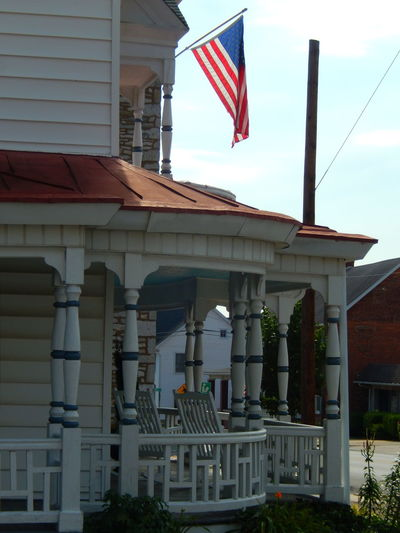 Great Wraparound Porch - The Graphic City EyeEm EyeEm Getty Collection EyeEm Gallery Pennsylvania The Graphic City Architecture Building Exterior Built Structure Chairs Day EyeEm Around The World Flag Flag Pole No People Outdoors Patriotism Porch View Pride Railings Sky Stars And Stripes