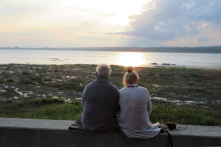 Sunset Sea Water Togetherness Horizon Over Water Senior Adult EyeEm Best Shots Sitting Senior Women Real People Sky Nature Two People Beach Women Beauty In Nature Relaxation Love Leisure Activity Looking At View Couples Shoot Couple Cuteness Couple In Nature Blue Sky River View