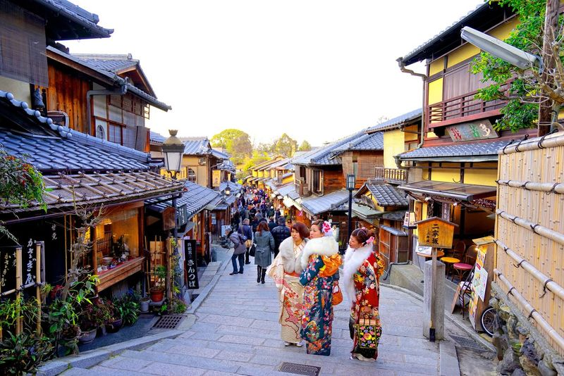 Kyoto. by SONY A7R. Kyoto Japan Culture Travel Temple Walking Around Staircase Street Market Traditional Clothing Large Group Of People Outdoors People Building Exterior Group Of People Real People Built Structure Roof Day Lifestyles Sky City Architecture