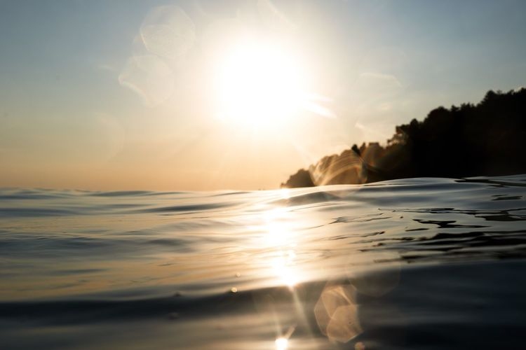 Sunset Sun Sea Beauty In Nature Scenics Nature Tranquility Tranquil Scene Sky Water Sunlight No People Outdoors Horizon Over Water Day Reflection Idyllic Lens Flare Sunbeam