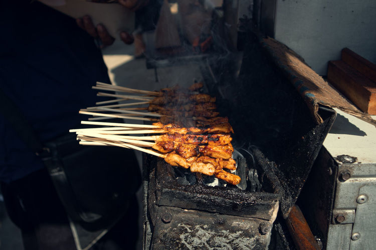 High angle view of meat cooking on barbecue grill