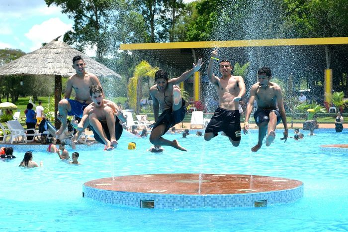 Jumper! Swimming Pool Vitality Sunlight Outdoors Celebration Swimming Jump Friendship Friends Travel Friends Having Fun Five LivingLife Young Men Water Blue Pool Time Poolday