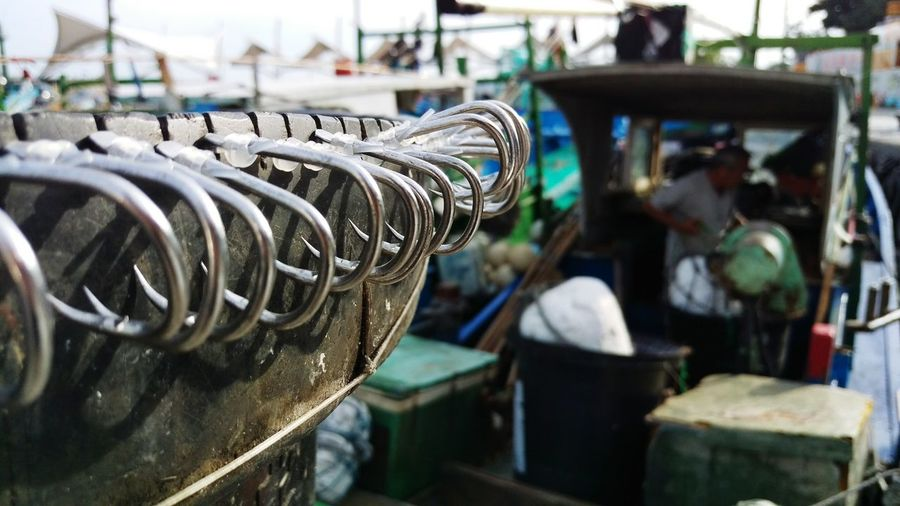 Close-up of fishing hooks on boat at dock