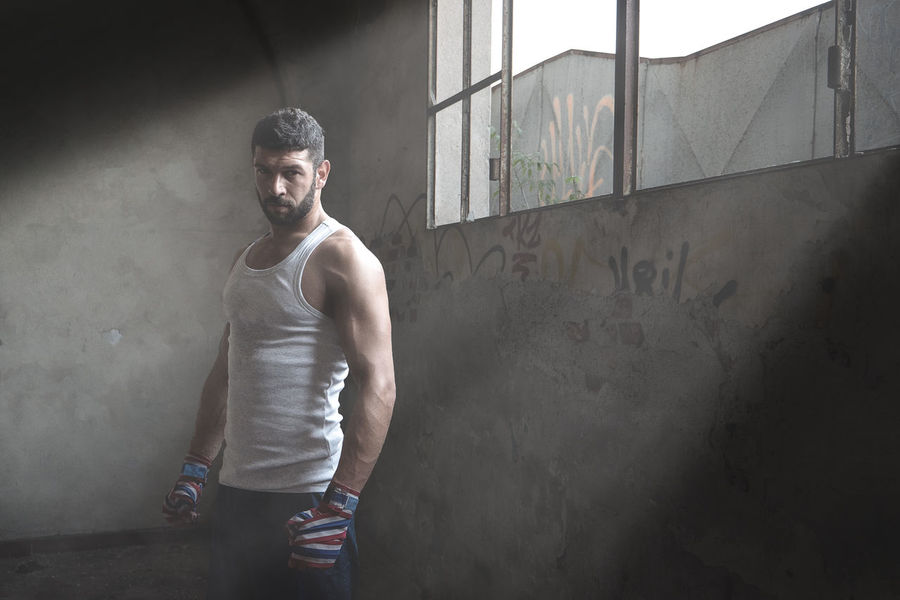 Muscular male boxer standing near window in abandoned building. Body & Fitness Boxer Light Man Architecture Boxe Boxing - Sport Fit Fitness Fitness Model Fitness Training Indoors  Lifestyles Looking At Camera Malephotographerofthemonth Muscular One Person People Real People Sport Standing Young Adult