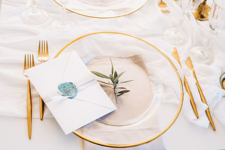 High angle view of white plate on table