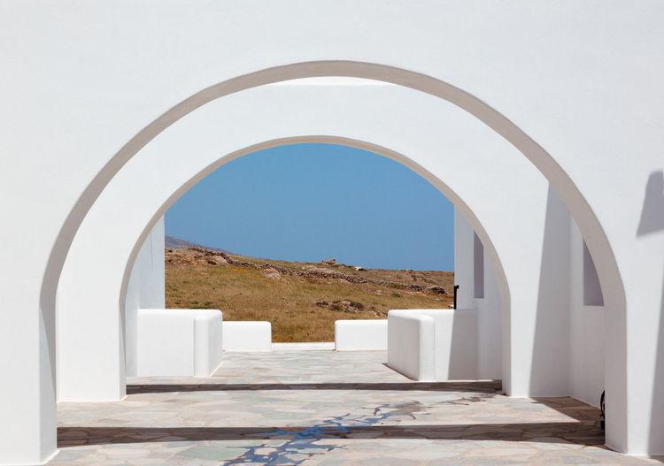 Corridor of building against clear blue sky