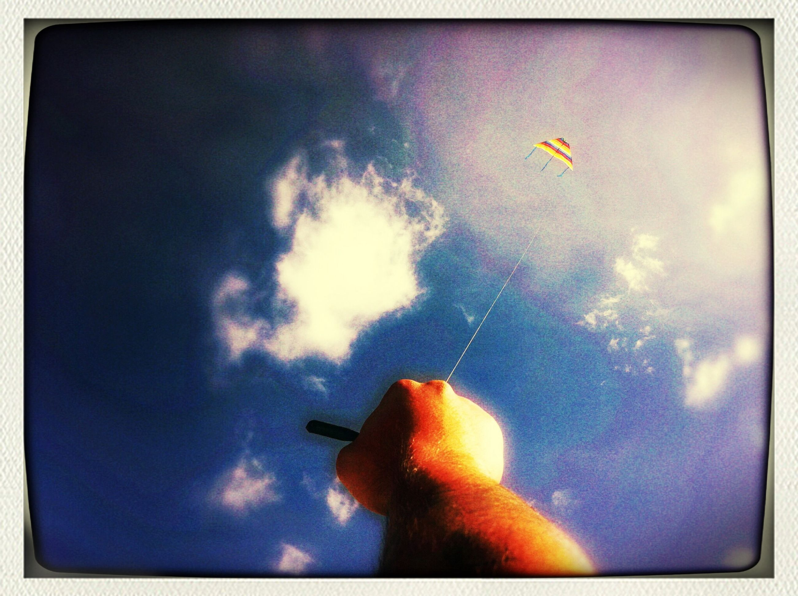 transfer print, auto post production filter, low angle view, sky, animal themes, flying, one animal, cloud - sky, wildlife, blue, animals in the wild, silhouette, unrecognizable person, leisure activity, cloud, mid-air, lifestyles