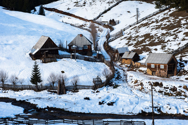 Houses on snow covered landscape during winter