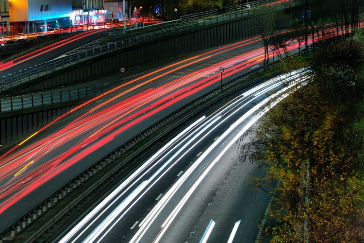 Architecture Blurred Motion Building Exterior Built Structure City City Life City Street High Angle View Highway Illuminated Light Trail Long Exposure Motion Multiple Lane Highway Night No People Outdoors Road Speed Street Traffic Transportation
