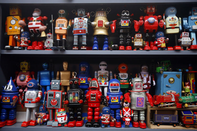 Tin toy robots on display at a shelf. Display Kid's Toys Kids Stuff Order Robot Shop Tin Toys Toy Photography Toys Showcase: February Toy Kingdom Children's World Young At Heart Toy Robot Screensaver Robots
