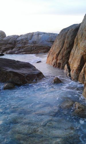 Seaside Stone Cold Temperature Oceanside Tranquility Shore Scenics Rocky Beach Adverture Sky Travel Beuty Of Nature Water Wave Splash Waves And Rocks Waves, Ocean, Nature Motion Island Sunset Outdoors Wave Nature Rocky Mountains Rock - Object Sea