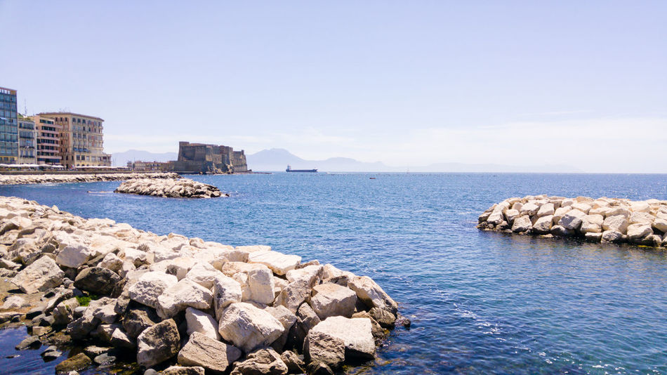 Beauty In Nature Built Structure Clear Sky Horizon Over Water Naples, Italy Napoli Nature Outdoors Rock - Object Scenics Water