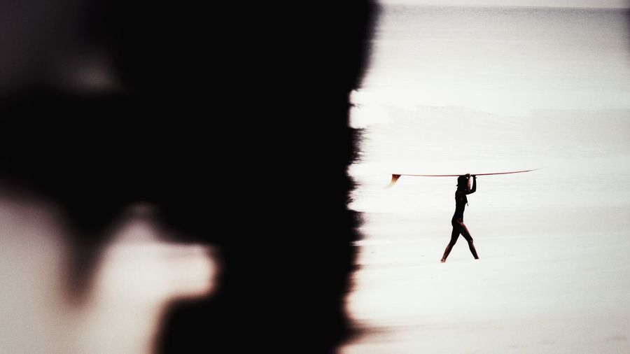 Silhouette woman standing in sunlight