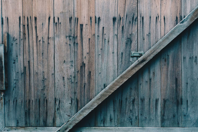 Wood - Material No People Full Frame Day Architecture Textured  Built Structure Close-up Pattern Backgrounds Safety Wall - Building Feature Outdoors Security Metal Barrier Old Protection Door Boundary Deterioration Nail Corrugated