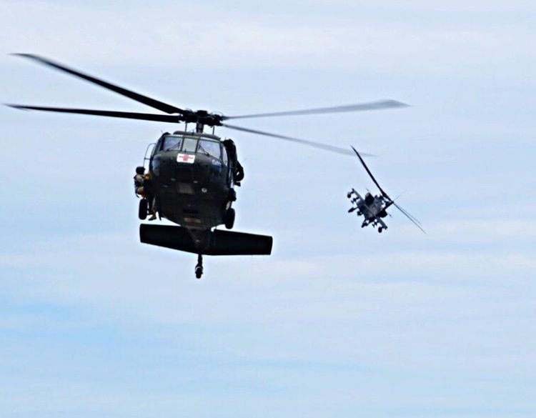 Helicopter Transportation Sky Mid-air Military Airshow Air Vehicle Flying Mode Of Transport Low Angle View Day Outdoors Nature Technology Huey Apache Apache Helicopter Medic  Rescue First Eyeem Photo