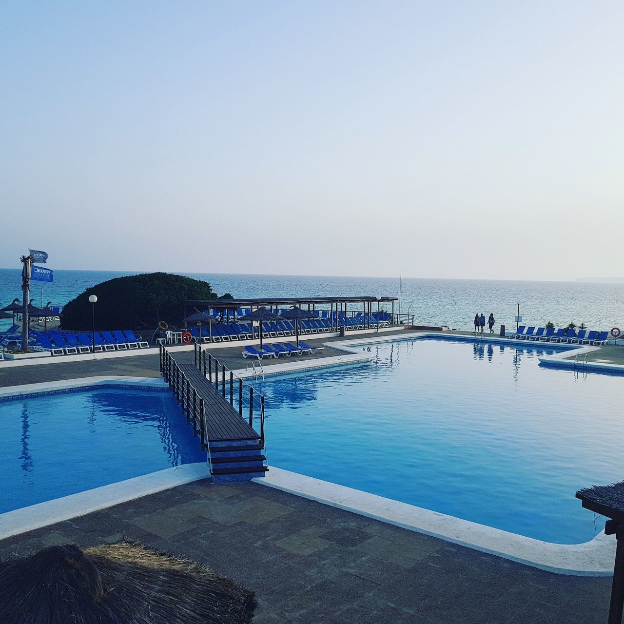 water, sky, sea, clear sky, nature, copy space, scenics - nature, horizon, horizon over water, beauty in nature, swimming pool, real people, blue, day, group of people, architecture, built structure, incidental people, leisure activity, outdoors