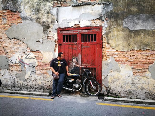 The World of Penang , Malaysia Transportation Outdoors Men Mode Of Transport People Day Land Vehicle One Person Red Architecture Real People One Man Only Only Men Done That. Been There. EyeEmNewHere Lost In The Landscape