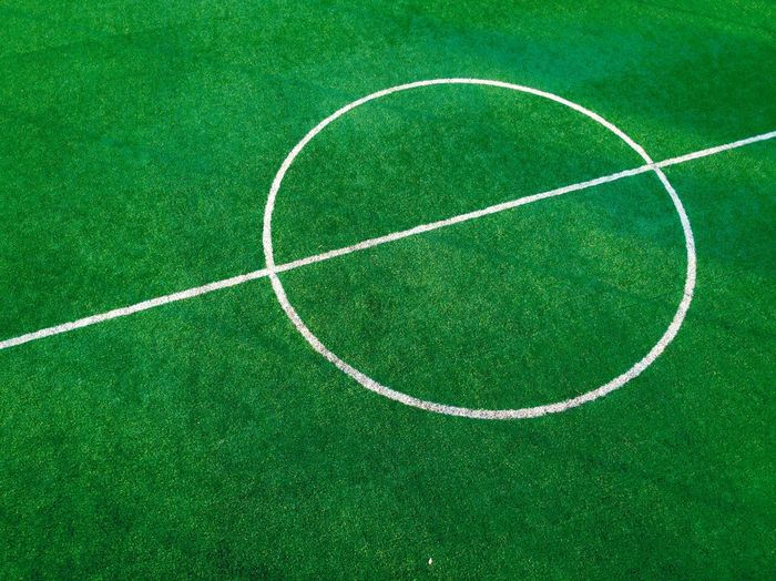 Football field Green Color Minimalism Shapes Angle Close-up Earial Dji Dronephotography DJI Mavic Air EyEmNewHere Drone  Aerial View Sport Green Color Playing Field Grass No People Soccer High Angle View Geometric Shape Soccer Field Court Circle Competition Competitive Sport Team Sport Plant Day Outdoors Sports Equipment