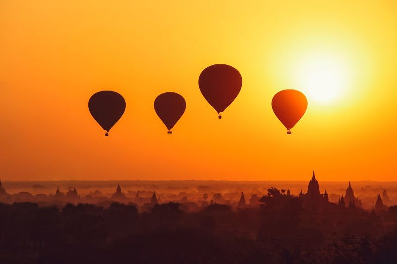 Silhouette of hot air ballons over bagan at sunrise in misty morning, myanmar