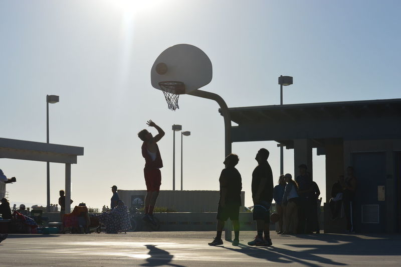 Adult Architecture Basketball - Sport Clear Sky Crowd Day Full Length Large Group Of People Leisure Activity Lifestyles Men Outdoors People Real People Silhouette Sky Sport Sportsman Stadium Standing Sun Sunlight Women