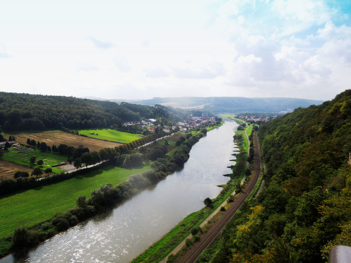 Blick auf die Weser Beauty In Nature Cloud Cloud - Sky Clouds And Sky Grass Green Color High Angle View Hill Idyllic Landscape Landscapes With WhiteWall Mountain Mountain Range Nature River Scenery Scenics Sky Tranquil Scene Tranquility Tree Water Weser