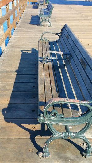 Bench Creative Light And Shadow Favorite Place To Watch World Go By Full Frame In A Row Metal Ocean Old Pattern Pier Benches Plank Protection Repetition Shadow Structure Wood Wooden The EyeEm Facebook Cover Challenge Seal Beach, California Surf's Up