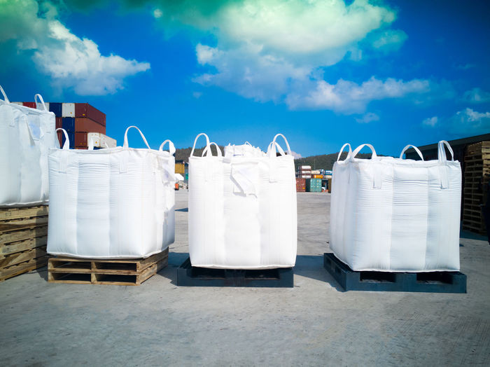 Sacks On Crate Against Cloudy Sky