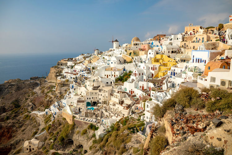 Greece Santorini Oia Thira Building Exterior Architecture Built Structure Building Residential District City Sky Nature Sea Water Day Plant Town Tree High Angle View Community Land No People House Outdoors TOWNSCAPE