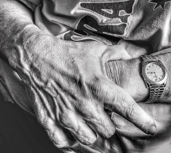 Close-Up Of Man Wearing Wristwatch